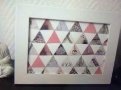 Dans des magasines ou dans vos photo, découpez des petits triangles et assemblez les pour créer ce design.