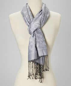 STAY WARM IN YOUR GLAMOROUS STRAPLESS WEDDING GOWN WITH THIS STUNNING ADDITIONAL PIECE.  Liven up a lackluster look with this style-savvy scarf. Perfect for spicing up any ensemble, this lightweight layer boasts an eye-catching paisley print and a sumptuously soft silk construction.