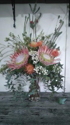 Tall king protea arrangement by RANE flowers