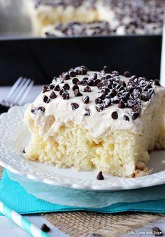 Cannoli Poke Cake - delicious cake topped with cannoli filling icing!