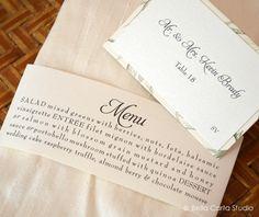 menu wrapped napkin fold and beautiful green and cream escort card by Bella Carta Studio.
