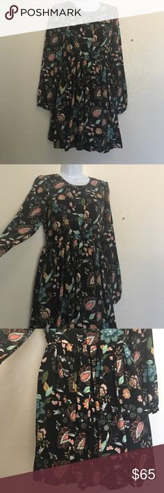 Romeo and Juliet Floral Black Long Sleeve Dress M NOTE!! The print on the ACTUAL dress is different from the cover photo but exact same style. New with Tag. Fit and Flare Floral Printed Black Long Sleeve Dress. Size 8-10. 100% polyester. Very beautiful  Romeo & Juliet Couture Dresses Long Sleeve