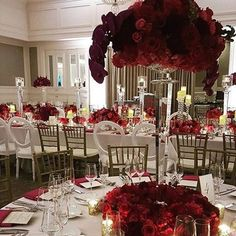 Striking red and white tablescape beauty with @lourdesmilian. Love the red orchid and rose blend. #LourdesMilian #red #redwedding #redweddingdecor #weddingdecor #weddingflowers #weddingtables #centerpieces #floral #flowers #redroses #roses #orchids #getti