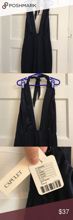Capulet Navy jumpsuit Long silk navy jumpsuit  Halter strap ties around neck Los Angeles-based brand Capulet was founded in 2011 as a collaboration between partners Giuseppe Valentini, Chris Berdine, and Nik Apostolopoulos. Fusing this womens line with a strong background in menswear design, Capulet is a collection of sophisticated and tailored pieces with a seductive and polished aesthetic. capulet Dresses