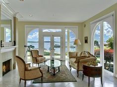 LHM Seattle - Luxurious waterfront estate designed for owners demanding utmost in elegant lakeside living and formal entertaining. Located in coveted gated exclusive community, Woodland Cove. Waves rolling gently up on the beach as the sunset dances across pavilions of glass, truly a sight for the eyes. This romantic Mediterranean resort style home with 108feet of cherished no bank waterfront with 100feet dock, private moorage, private 2 boat slip, 2 lifts & a swim ladder. Sweeping views…