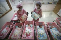 what a beautiful way to be welcomed into this world! Nurses check on the newborns in the Hello Kitty-designed maternity ward at the Hau Sheng Hospital in Taiwan in 2009.