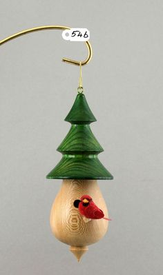 Wooden hanging birdhouse with a little cardinal / by Altheturner