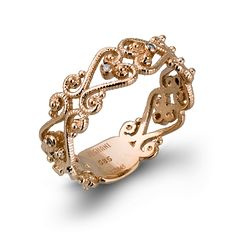 With intricate scroll patterns and milgrain accents, this flowing 14K rose gold band has .04ctw of white diamonds and is a perfect piece for our Vintage Vixen Collection.