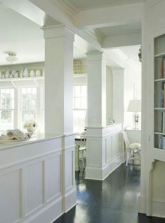 i like the pony wall, and the molding on the supports. Would LOVE that on my front porch.