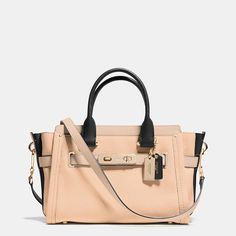 """Statement belting with double-turnlock hardware updates one of our most popular designs with a little bit of """"swagger."""" Thoroughly organized with three compartments and named for a bold, brass-trimmed Bonnie Cashin design from 1967, this spacious, modern carryall is finished by hand in colorblocked leather with a detachable strap for shoulder or crossbody wear."""