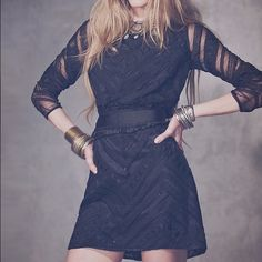 NWOT free people future heirloom New Romantics 4 Gorgeous black beaded free people mini dress with gorgeous ribbon detail. This dress is stunning. No flaws. Never worn. Retails at $350. Free People Dresses Mini