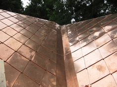 """Copper metal shingles are a great way to make your home energy efficient and green. Learn how to have a """"green"""" house from Fine Metal Roof Tech."""