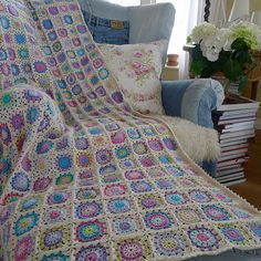 This one has me wanting to crochet a granny square blanket. The colours are divine.