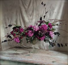 Whimsical flower arrangement of poppies, beech, sweet peas, Rosa glauca, Heuchera, Astrantia and grasses. So fun making these compote styled bouquets!
