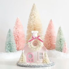 This Pretty in Pink Cottage is one of my favorite Putz House Ornaments!  #etsyshop #putzhouse #pink #pursuepretty #glitterhouse #pinkchristmas #papercraft #christmasdecor #crafty #diycrafts #bottlebrushtrees #happycolors #vintagechristmas #diykits #christmasvillage #makersgonnamake #handmadegifts #holidaydecor #creativelifehappylife #crafting