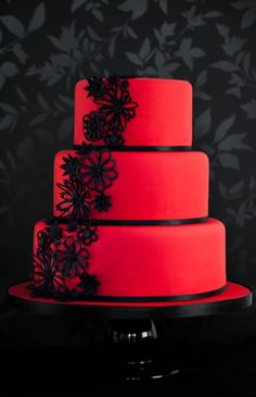 dramatic red cake with black flowers