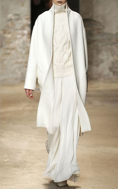 Sally LaPointe Felted Wool Cocoon Coat $1,980, Cashmere Cableknit Sleeveless Sweater $950, Double Georgette Wide Leg Pants $1,950