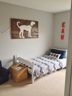 Big boy room - love the bedding and dog silhouette