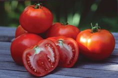 Tomatoes..Home grown.....don't like them but they remind me of grandma...slicing them for dinner and supper!