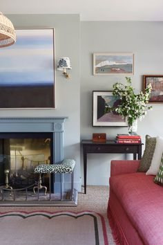 Pink tassel trim sofa and a scalloped rug by  Salvesen Graham