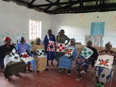The widows at the Widow Care C enter in Kenya proudly displaying their quilted bags.