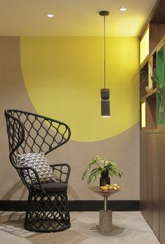 Wire chair and side table at a retro style hotel  in Rio de Janeiro
