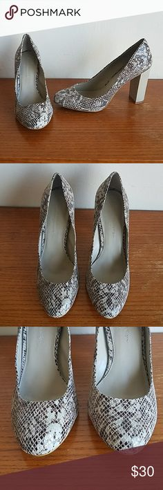 BANANA REPUBLIC Brown Taupe Snakeskin Heels Excellent Condition ~ Brown and Taupe Snake Skin Pattern ~ Has A Slight Gray Undertone In Certain Light ~ Chunky Heel ~ Material Content Is Unknown But Feels and Looks Like A Soft Leather.    UPPER: No Noted Tears,  Stains, Peeling, Fading or Scuffing  Heel Is Sturdy and Intact  Upper Shoe is Firmly Attached To Sole   INSOLE: Clean and Intact   SOLE: Some Wear and Scuffing Noted  Sole Is Intact with Strong Binding   All Measurements Are…