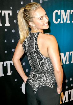 Hayden Panettiere gives an over-the-shoulder smile at the CMT Artists of the Year bash.