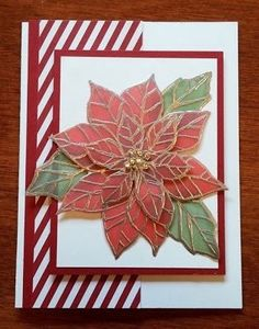 handmade Christmas card from Seongsook's Creations ... vellum layered poinsettia ... gold embossing on red and green vellum ... multiple layers cut out and layers ... great layout too ...: