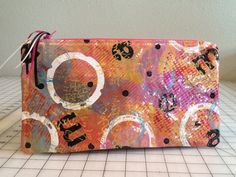 Zippered cosmetic bag. Lifted from a gelli plate onto vinyl. Lined with cotton.