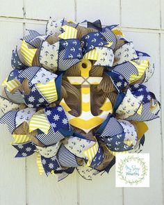 Welcome family and friends year after year with this unique anchor wreath!! It is the perfect addition to your home decor. A burlap pencil work wreath form is the base for the burlap jute mesh. Premium quality cream burlap/blue anchor, blue burlap/white anchor, blue/cream ladder, blue satin white boat wheel and white/yellow ladder wired ribbon give depth to this nautical inspired wreath. A distressed white/yellow chevron pattern wooden anchor completes this wreath. The anchor was purchased…