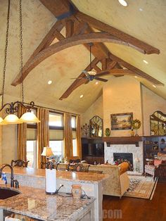 Faux wood beam in Tuscany highlights this reasonably sized but stylish great room.  #kitchen #diningroom #highceilings
