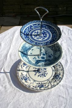 A Hand Compiled Cake Stand Made Of Vintage Blue and by FannyandLil, £25.00