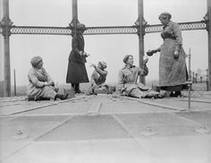 11th June 1918: Workers at the Gas Light and Coke Company at Bromley By Bow, London, serving tea on top of a gasometer. (A.R. Coster/Topical Press Agency/Getty Images)