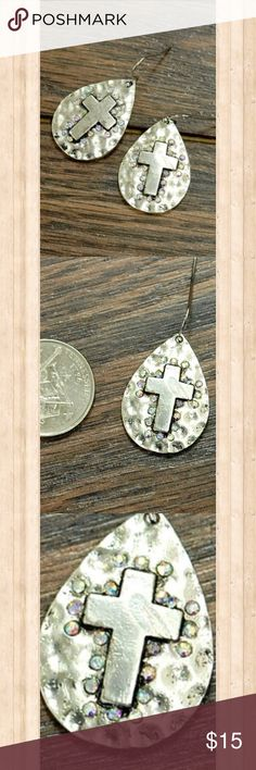 "Hammered cross dangle earrings Silver tone teardrop shaped hammered cross earrings feature shimmering rhinestones for added bling. 1.5"" length. Jewelry Earrings"