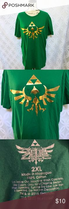 """Nintendo The Legend Of Zelda Triforce Tee Nintendo The Legend Of Zelda Triforce Tee NWOT.                   Measurements Laying Flat Size 🔹 2XL  Armpit to Armpit 🔹25"""" Shoulder to Hem 🔹32"""" Bundle to Save 🤓 Sorry NO outside transactions 🚫 NO trades 🚫 Reasonable Offers welcomed 👍 NO Low balling 👎 NO modeling 👎 NO Holds👎 All items from a pet 😼and Smoke Free Home  Happy Poshing 🤗 Nintendo Tops Tees - Short Sleeve"""