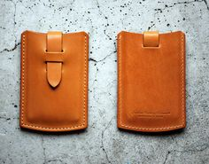 ROBERU, LEATHER CARD CASE: $50 and also comes in a really nice red or black.