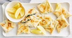 Spinach and feta triangles meet Turkish gozleme in this easy finger food recipe.
