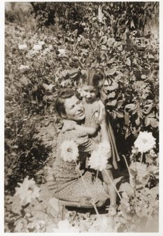 A Polish rescuer hugs the Jewish child she is hiding during a family outing in the country.  Pictured are Helena Biczyk and Zofja Fajnsztejn.