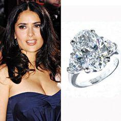 Salma Hayek has a 5 carat oval cut diamond with trillions on each side, set in platinum. https://www.facebook.com/SpitzJewelers