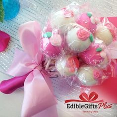 Here comes a surprise gift! This lovely Cake Pop Bouquet 18 cake pops decorated with colorful flowers made of icing. For best edible gifts, don't forget to shop at Edible Gifts Plus.