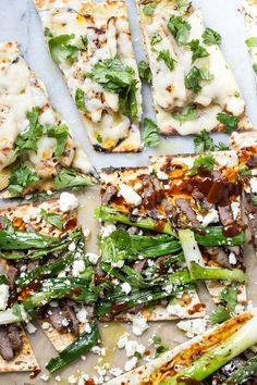 Flatbread pizza thrown on the grill and topped with either sliced chicken or steak, jack cheese, grilled green onions and grilled potato slices.