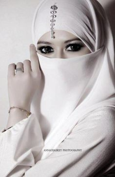 Gorgeous eyes and beautifully accessorized