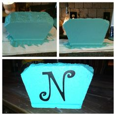 I painted an extra cement garden block a bright color and attached our  initial.