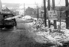 An American jeep enters the shell-torn town of Houffalize, by the main road. The town was retaken from the Germans by the 2nd Armored Division. 18 january 1945.