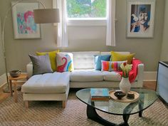 Bright pillows and neutral walls with white Karlstad leather sofa.