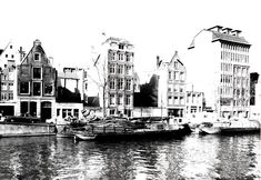 1969. A view of the Zwanenburgwal in Amsterdam. The Zwanenburgwal is a canal and street that flows from the Sint Antoniessluis sluice gate (between the Sint Antoniesbreestraat and Jodenbreestraat) to the river Amstel. The Waterlooplein flea market runs along the Zwanenburgwal. Many of the building on the canal have been demolished in the late 1960's and 1970's. Photo Stadsarchief Amsterdam / J. M. Arsath Ro'is. #amsterdam #1969 #Zwanenburgwal