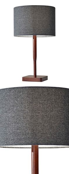 The beauty of simplicity is highlighted in this earthy design. Our Asher Table Lamp combines walnut wood with a textured gray fabric shade. It's a ruggedly handsome way to brighten up your workspace.  Find the Asher Table Lamp, as seen in the #Mid-Century Monochrome Collection at http://dotandbo.com/collections/mid-century-monochrome?utm_source=pinterest&utm_medium=organic&db_sku=120781