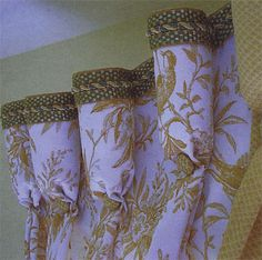 Goblet header with fabric covered button and top trim detail Drapery