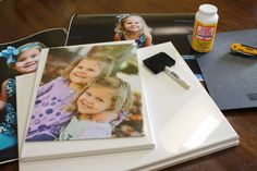 DIY Photo Canvas Tutorial by Designer Trapped in a Lawyer's Body {www.designertrapped.com} •Blank canvases •Enlarged photo prints {I get mine from Costco} •Mod Podge Matte Finish {*affiliate link} •Foam brushes •Black paint •Utility knife •Cutting board